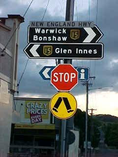 Sign reads: New England Highway Warwick Bonshaw 15 15 Glen Innes