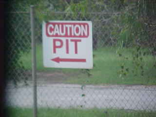 Sign reads: Caution Pit