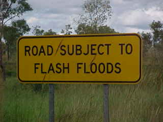Sign says: Road subject to flash floods