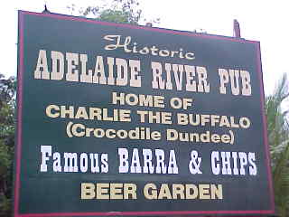 Sign reads: Historic Adelaide River Pub Home of Charlie the buffalo (Crocodile Dundee) Famous Barra & Chips Beer Garden