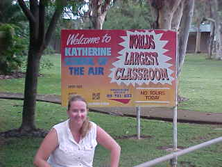 The sign behind SGK says: Welcome to Katherine School Of The Air Worlds Largest Classroom No Tour Today