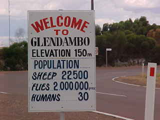 Sign reads: Welcome to Glendambo Elevation 150m Population Sheep 22,500 Flies 2,000,000 Humans 30