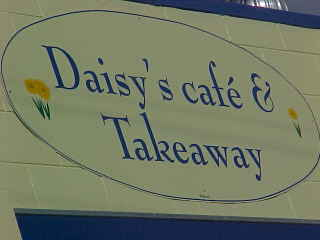 Sign says: Daisy's Cafe & Take Away