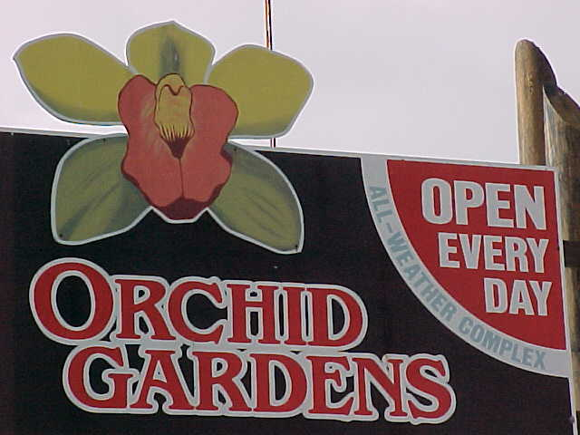 Sign says: Orchid Gardens.   Open Every Day.    All-Weather Complex (New Zealand, North Island, The Travel Addicts)