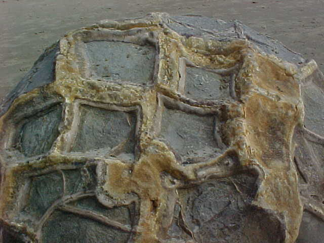 cross hatch pattern on a boulder.   (New Zealand, The Travel Addicts, South Island)