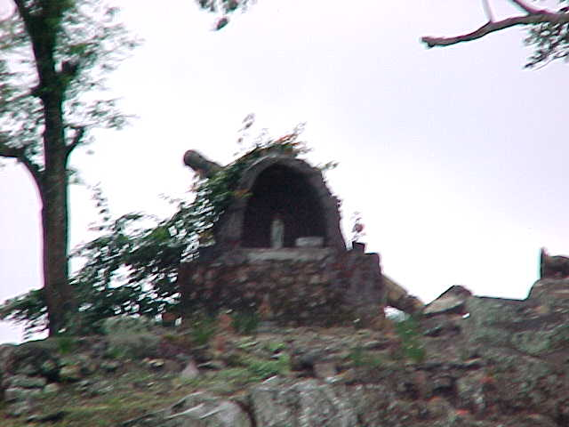 The only sign of their official Catholic religion - it was built by the government, not the people of the village (Indonesia, The Travel Addicts)