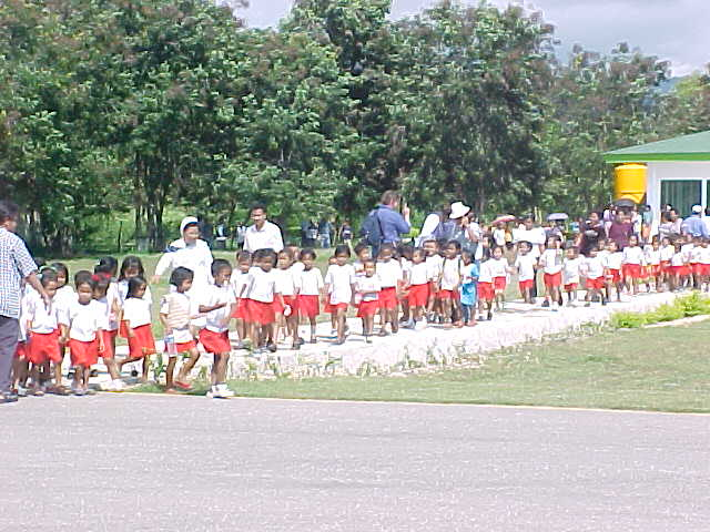 Indonesian children all lined up in their school uniforms.  .  Location: Suumba School, Tambolaka Flores, East Nusa Tengarra, Indonesia (Indonesia, The Travel Addicts, Flores)
