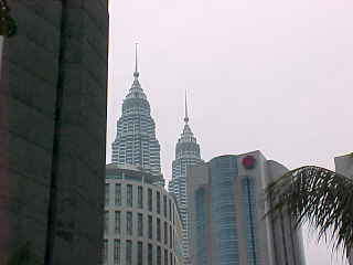 The Petronas towers peek out above the skyline