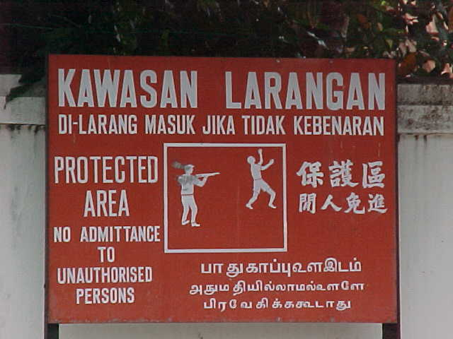 Common Malaysian no trespassing sign : Boy are these guys serious! (Malaysia, The Travel Addicts)