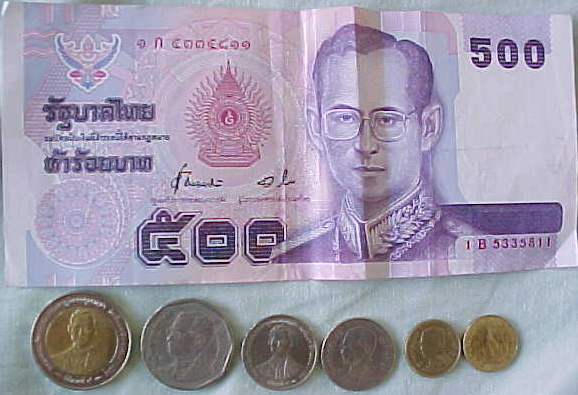 MVC-820S-Thai currency. : 500 Baht note with coins of various smaller denominations.  The Baht (THB) is a Southeast Asian standard.  It hovered around 40 to the dollar whilst we were there.  That's the king on the banknote. (The Travel Addicts, Thailand)