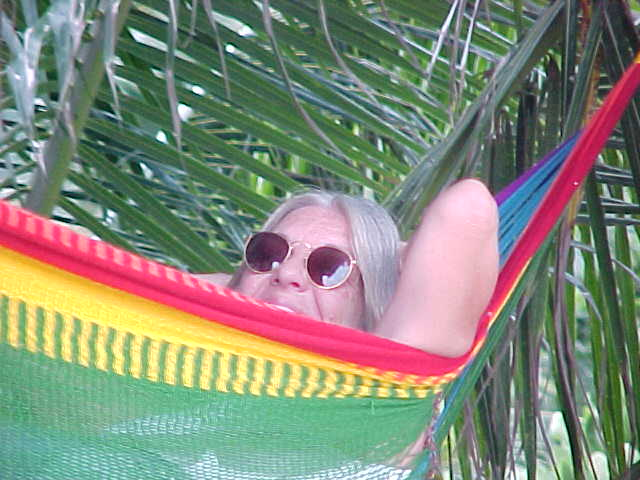 Jane relaxing in her usual pose :  (Thailand, The Travel Addicts)