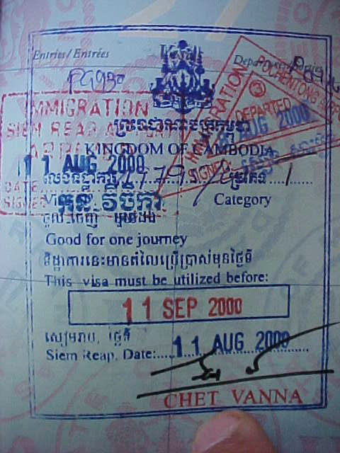 MVC-797S-Cambodian visa and entry stamp. : Visa's are required of everyone, and are freely handed out to westerners upon landing and handing over 0.00US (local currency NOT accepted) (The Travel Addicts, Cambodia)