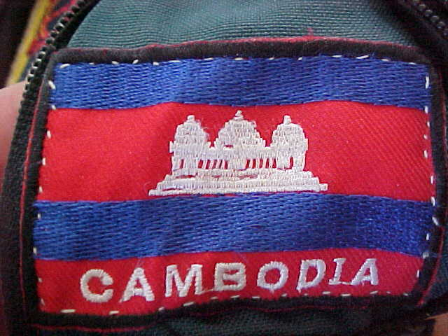MVC-798S-Cambodian flag patch for our backpacks.  (The Travel Addicts, Cambodia)