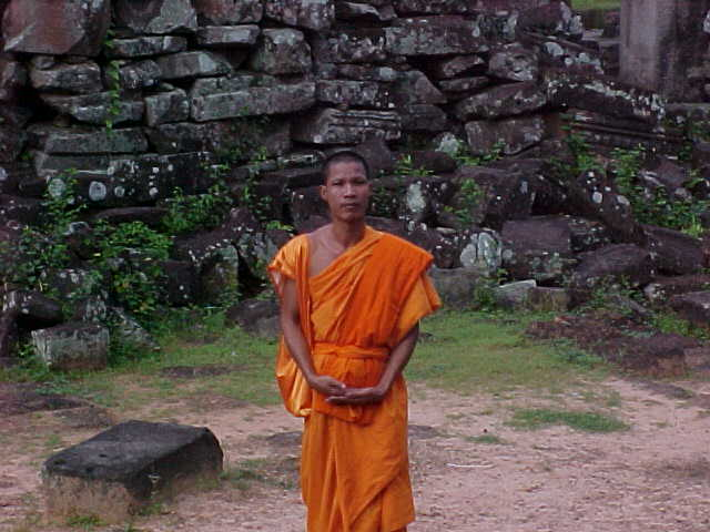 Monk : This guy would not take a tip for the photograph (Cambodia, The Travel Addicts)