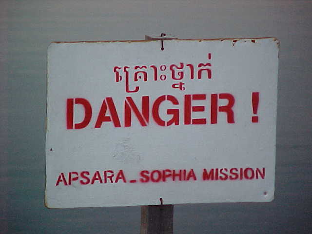 Land mines are still present in much of Cambodia : Sign says: \ (something in Khmer) \ Danger! \ Apsara_Sophia Mission (Cambodia, The Travel Addicts)