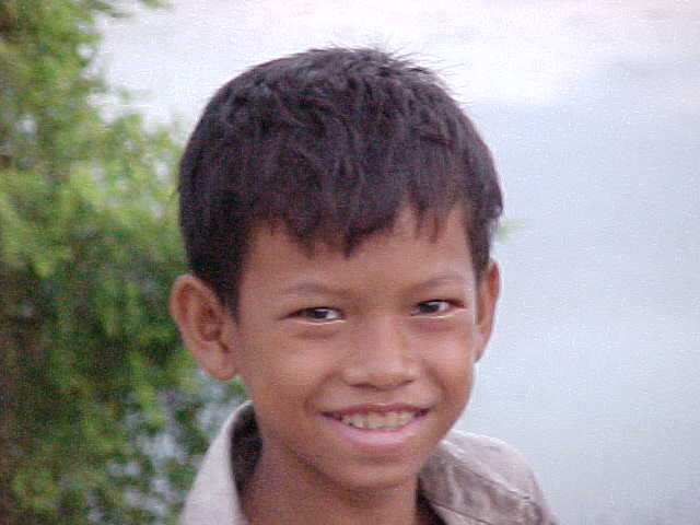 Boy who liked our video : Many children in Cambodia have never seen a video camera nor themselves on video, so this was a novelty. (Cambodia, The Travel Addicts)