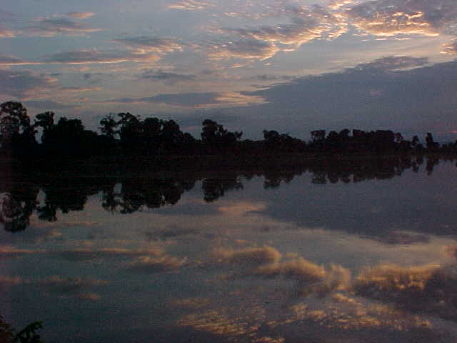 Reflection in the pool (Cambodia, The Travel Addicts)
