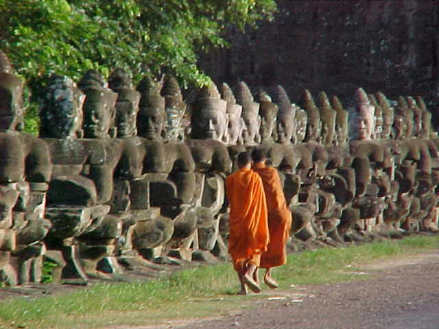 Monks at the victory gate :  (Cambodia, The Travel Addicts)