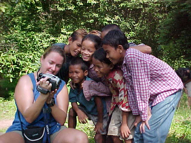 Children love seeing themselves on video :  (Cambodia, The Travel Addicts)