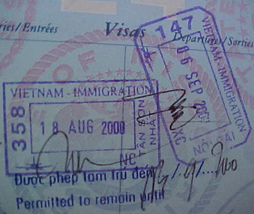 MVC-795S-Entry and exit stamps.  (The Travel Addicts, Vietnam)
