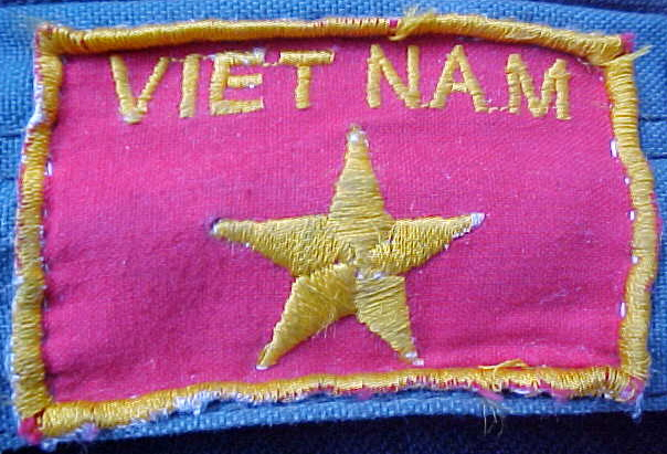 MVC-796S-Flag for our backpacks.  (The Travel Addicts, Vietnam)