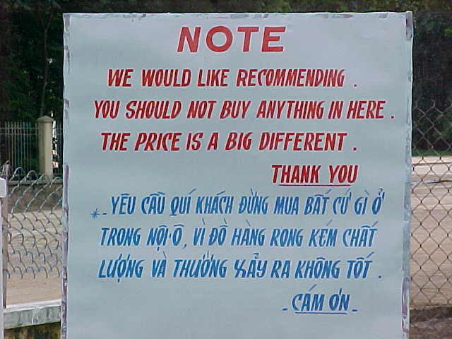 Sign outside the temple : Sign reads: \ Note \ We would like rcommending you should not buy anything in here.  The price is a big different. \ Thank you (Vietnam, The Travel Addicts)