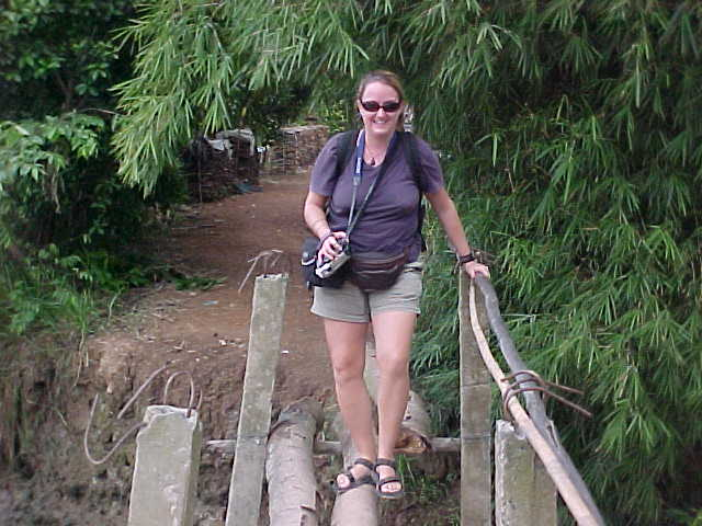 SGK on a one log bridge (Vietnam, The Travel Addicts)