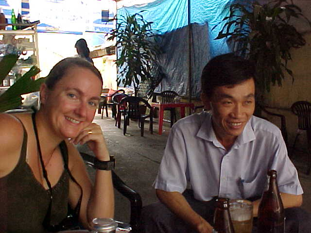 SGK and a new friend : This guy met us on a rainy day in a park.  He just walked up to us and asked if we would join him for a beer.  It turns out he was moving to Canada to be with his wife. (Vietnam, The Travel Addicts)