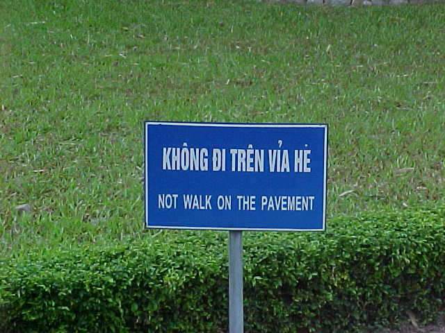 "Sign outside of Ho Chi Mihn's tomb : Sign reads: ""Not walk on the pavement"" (Vietnam, The Travel Addicts)"
