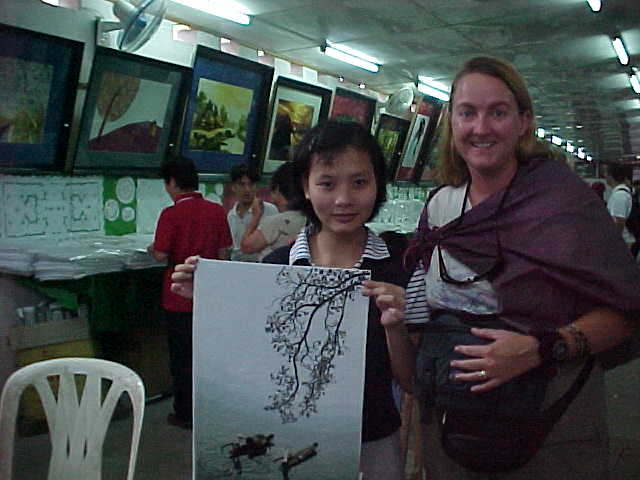 Disabled artist with SGK's purchace :  (Vietnam, The Travel Addicts)