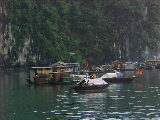 Floating village :  (Vietnam, The Travel Addicts)