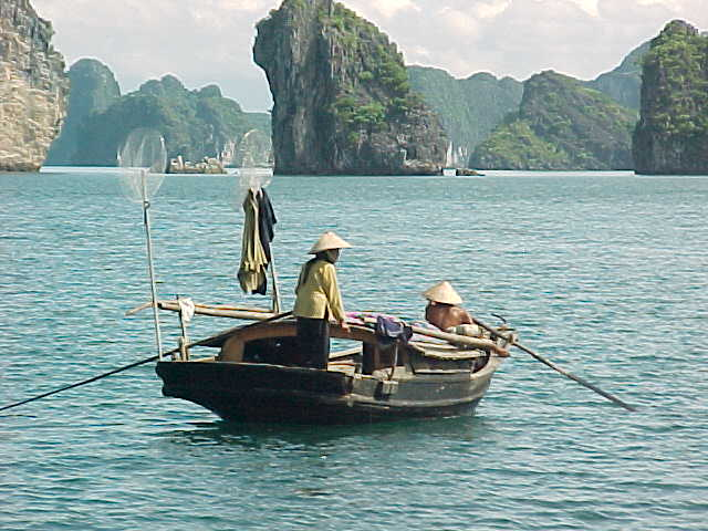 Locals on Ha Long Bay :  (The Travel Addicts, Vietnam)