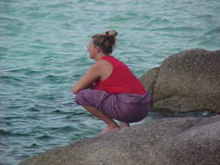 SGK practicing Yoga before the storm : Squatting Monkey (The Travel Addicts, Thailand)