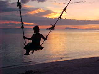 Israeli girl on swing at Cocohut :  (The Travel Addicts, Thailand)