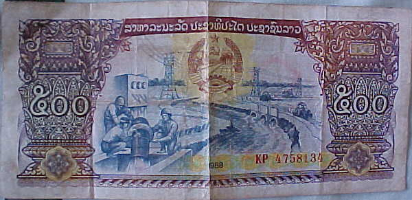 MVC-819S-Lao Kip. : Not sure the denomitation of this banknote as it's in Sanskrit script, but there were about 70,000 Lao Kip to the dollar whilst we were there and the largets banknote only had two zeros on it so it largely did not matter. (The Travel Addicts, Laos)