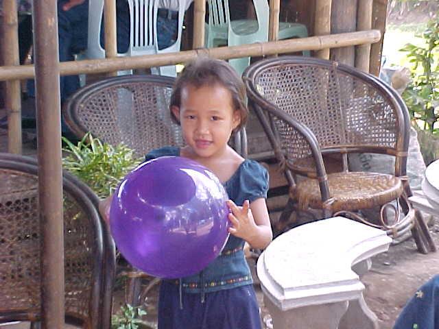 Baloon recipient (Laos, The Travel Addicts)