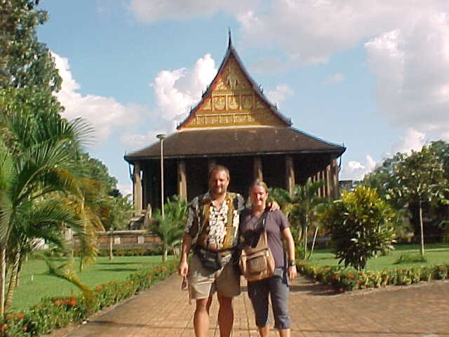 Me and SGK in front of royal temple (Laos, The Travel Addicts)