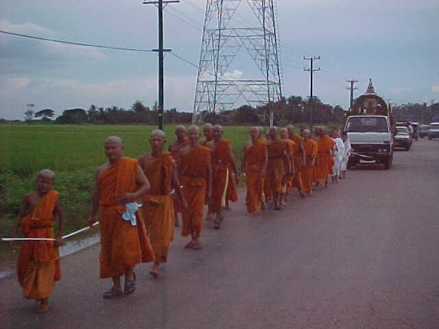 Funeral procession (Laos, The Travel Addicts)