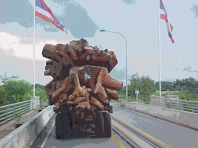 Truckload of Teak heading south : Laos' teak forests are disapearing into the furniture and architecture of Thailand (Laos, The Travel Addicts)