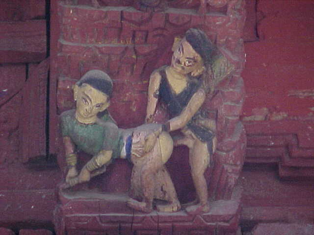 Kama Sutra : These scenes from the Kama Sutra adorn the eaves of temples to keep lightning away as the goddess of lightning is a virgin and too shy to witness such artwork (Nepal, The Travel Addicts)