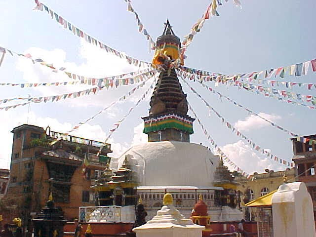 Mini Swayambhunath stupa with prayer flags : Mini Swayambhunath is a copy of the Swayambhunath Pagoda that requires many steps to get there. This one was built in the 1600's to allow those that could not climb the steps to attend the pagoda. (Nepal, The Travel Addicts)