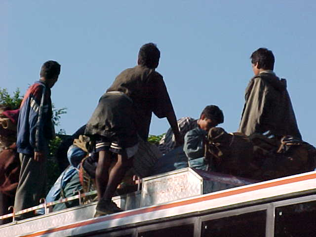 Loading the bus (Nepal, The Travel Addicts)