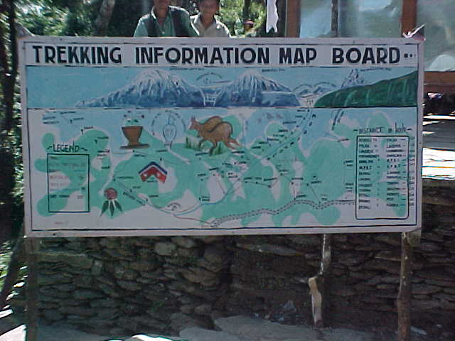 Trek board : (Sign says: Trekking Information Map Board) (Nepal, The Travel Addicts)