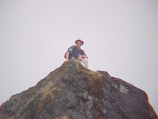 Richard on an outcropping (Nepal, The Travel Addicts)