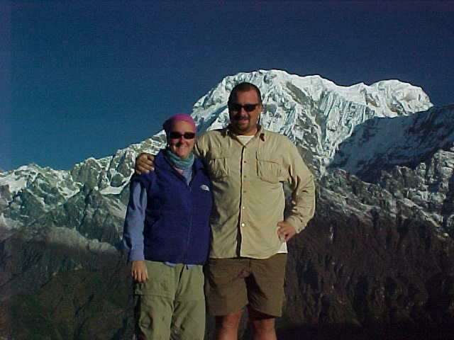 I prefer the one with glasses as I'm not squinting in it (Nepal, The Travel Addicts)