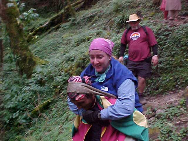 SGK hurts her ankle and has to be carried down the mountain by Kirin (and later by Captain) (Nepal, The Travel Addicts)