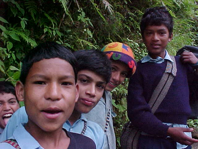 """School children : The one in the colourful hat speeks perfect English and """"wants to be a guide for Himalayan Encounters when he grows up."""" \  (Nepal, The Travel Addicts)"""