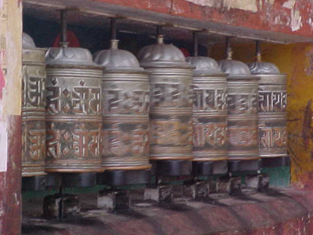 Spinning prayer wheels : A tibetan invention designed as a shortcut to saying your prayers. The prayer is on a scroll inside the wheel; spinning it clockwise says the prayer for you. (Nepal, The Travel Addicts)