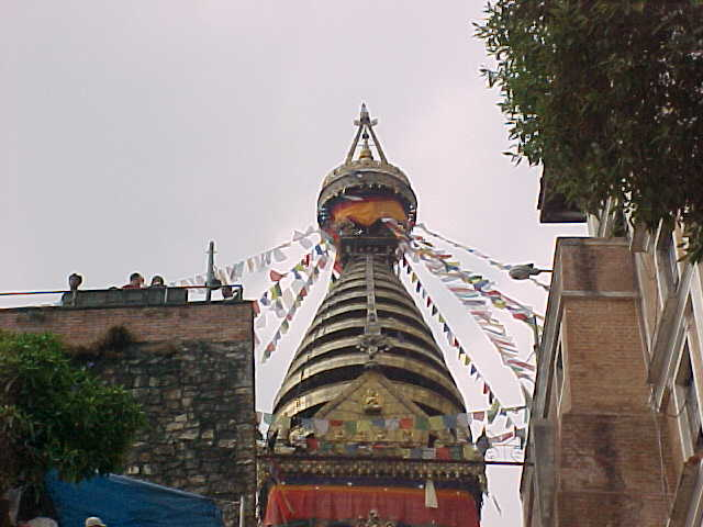 Pinicale of the stupa with prayer flags (Nepal, The Travel Addicts)