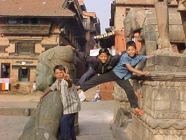 Children showing off for the camera at Nyatopala temple (Nepal, The Travel Addicts)